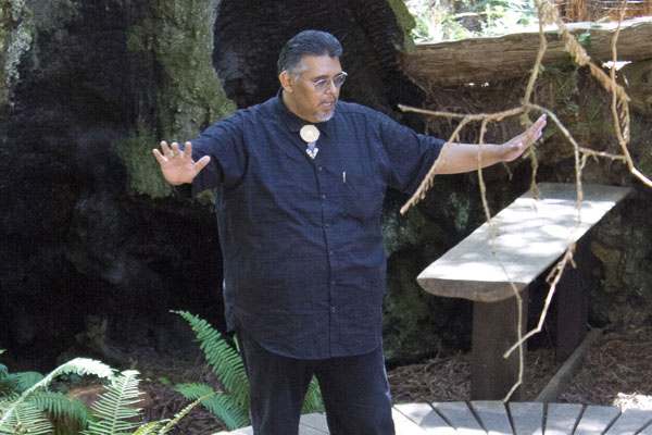 Eric Wilder telling Kashaya history in the redwood grove