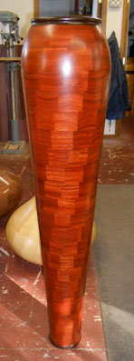 Handcrafted 54-inch tall vase 'Twister' made from exotic African red padouk and wenge woods by Robert Gauthier