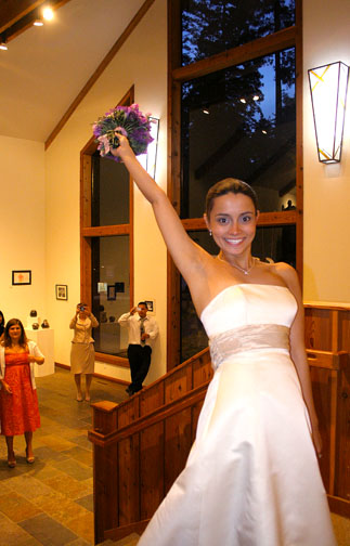 Tossing the bouquet in the Foyer photo by Ron Bolander